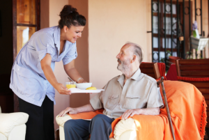 caregiver assisting his patient in walking